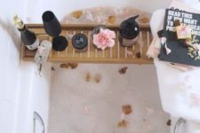 09 fill the bathtub with petals and place a caddy with wine, candles, flowers and some magazines or books to read