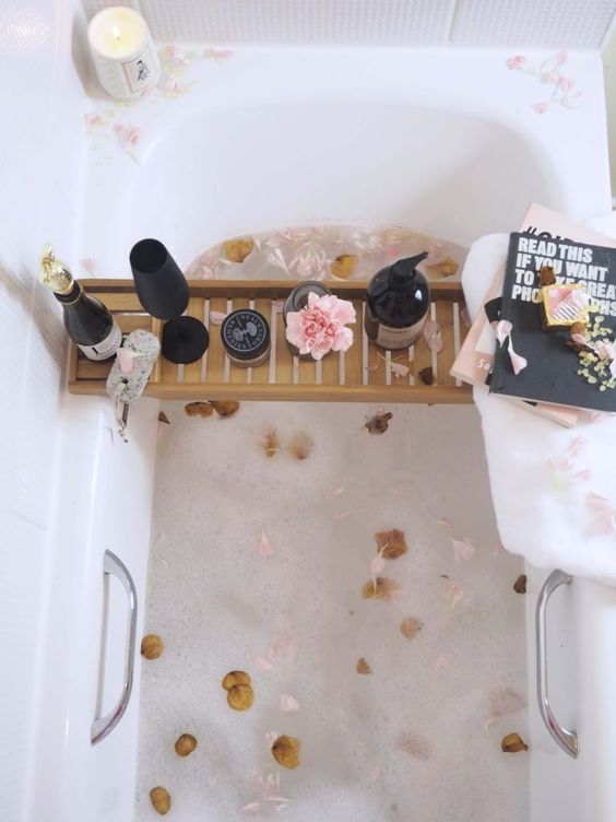 fill the bathtub with petals and place a caddy with wine, candles, flowers and some magazines or books to read