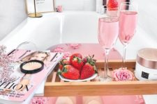 10 a pink bath for Valentine's Day with pink roses, pink wine, fresh strawbrries and a luxury scrub
