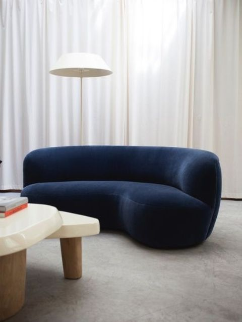 a sophisticated curvy navy velvet sofa is a chic touch to your space and a bold colorful statement