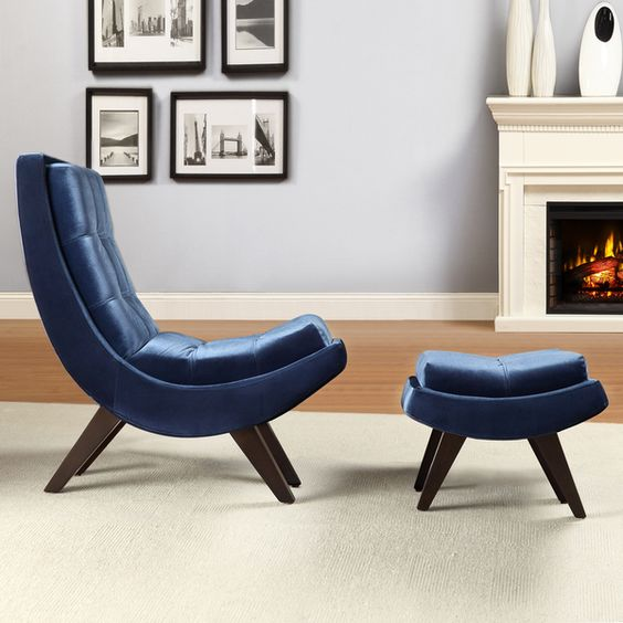 a comfy navy velvet curved chair with a matching curved footrest for a cozy nook