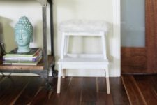 12 IKEA Bekvam step stool with faux sheepskin from IKEA is a stylish modern option for your home