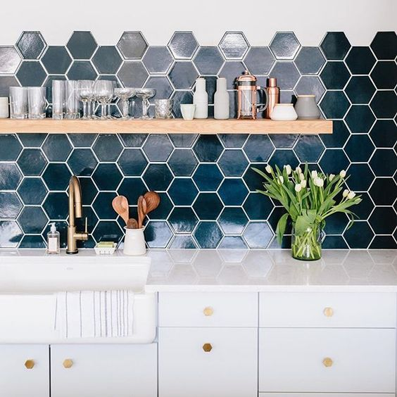 chic dark green hexagon tiles with white grout make a bold statement in a neutral space