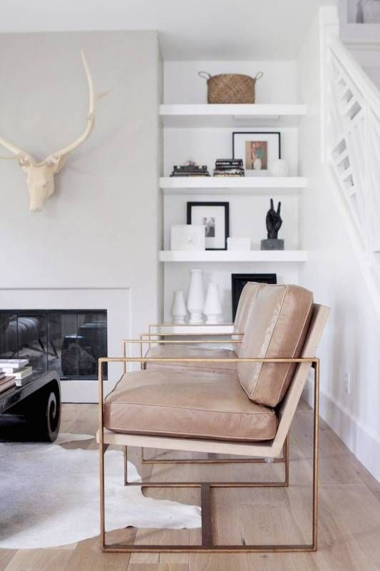 taupe leather chairs with very thin copper framing for a bold contemporary look