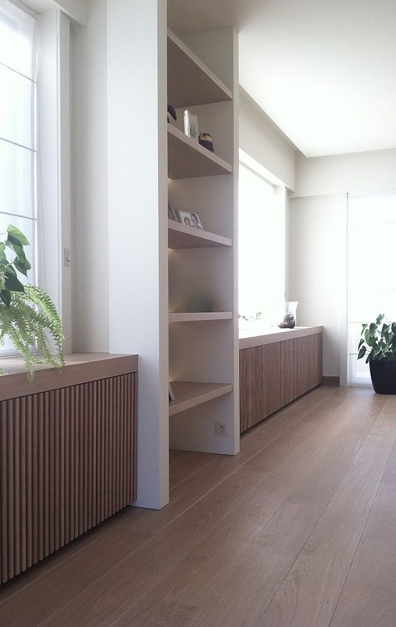 wooden plank screens cover the radiators very well and keep your space stylish and cool