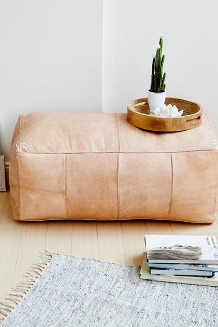 a blush leather ottoman will complete your boho chic space and make it cooler