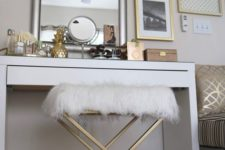 13 a glam brass geometric stool with a faux fur seat from IKEA