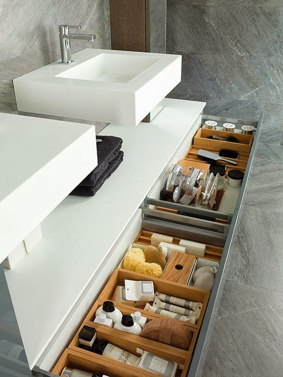 a vanity with several drawers incorporated allows storing a lot