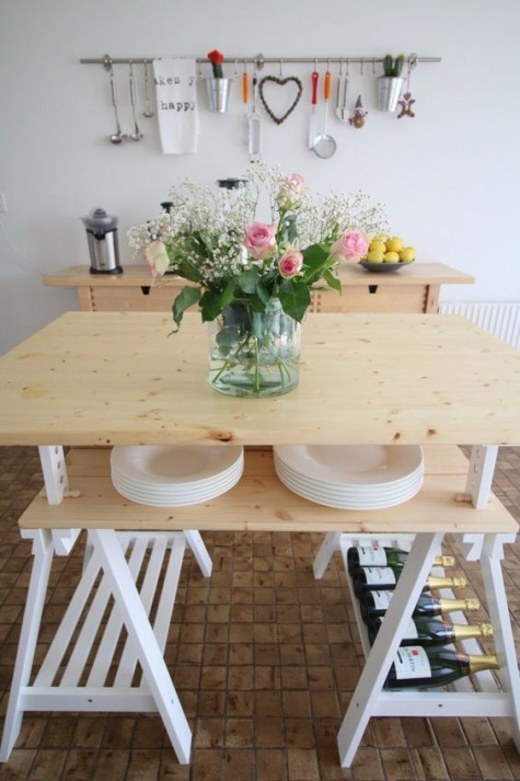 a DIY kitchen island of IKEA Finnvard legs and two wooden tops for storage inside