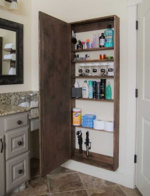 a whole wall cabinet hidden under a mirror is a great idea if you need much storage space in your bathroom