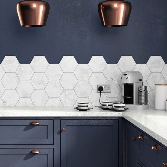 marble medium scale hex tiles accent the navy kitchen and create a contrating look