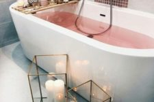 16 pink water in the bathtub, candles including aromatic ones, white and pink blooms and large lanterns with candles