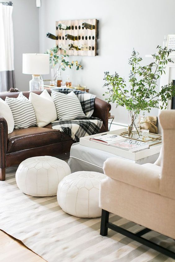 white leather Moroccan poufs immediately add interest to your space