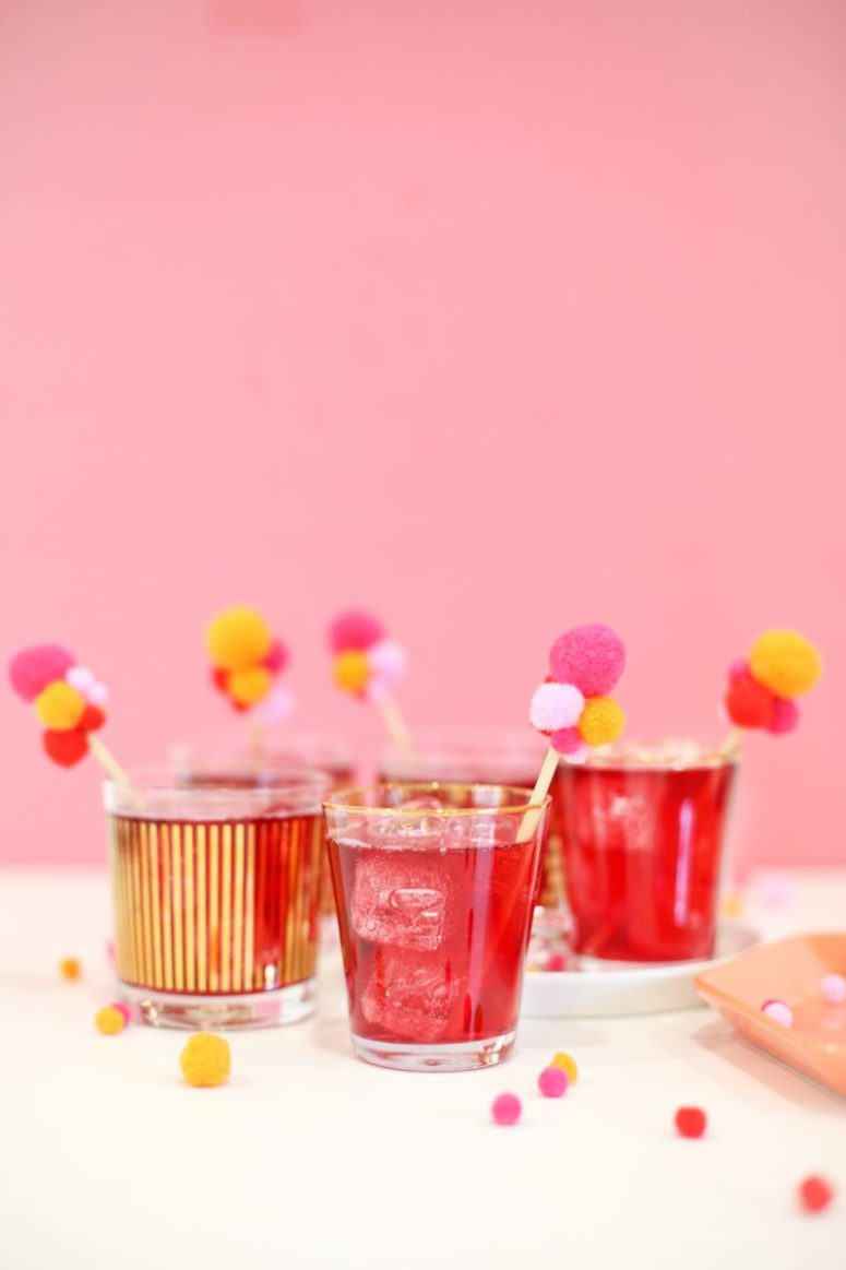 DIY colorful pompom drink stirrers for Valentine's Day (via lovelyindeed.com)