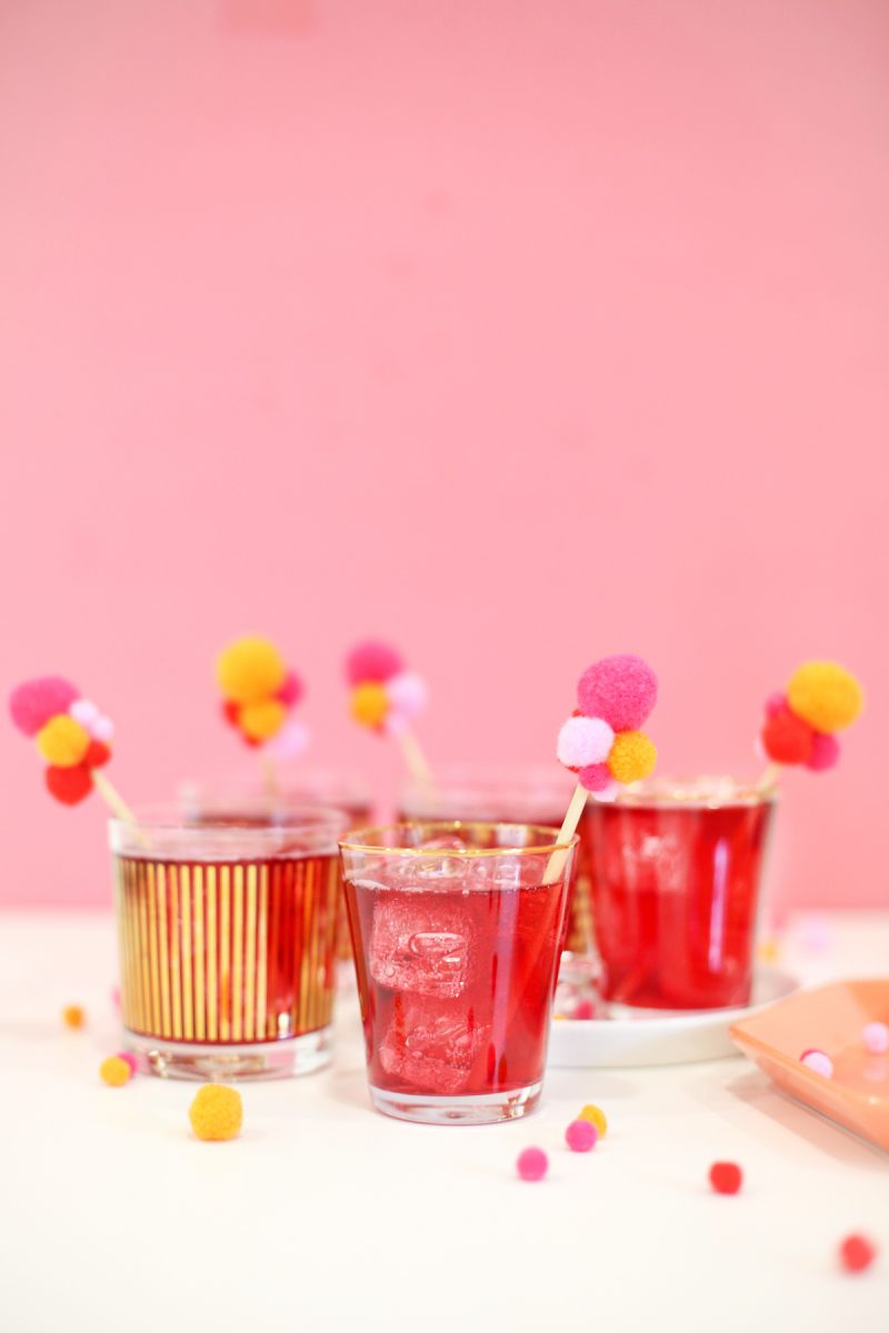 DIY colorful pompom drink stirrers for Valentine's Day