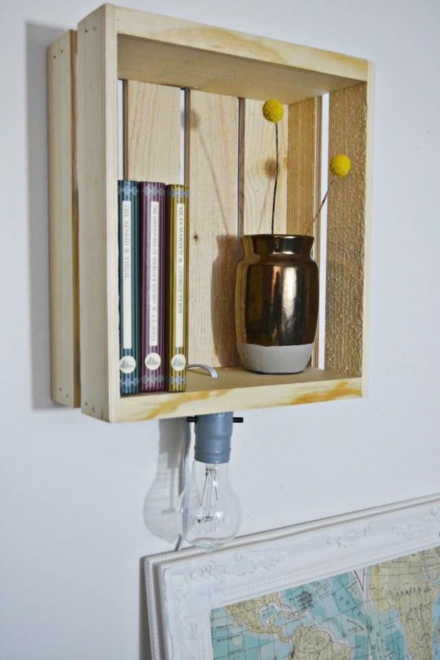 DIY crate sconce shelf to save some floor space (via www.ajoyfulriot.com)