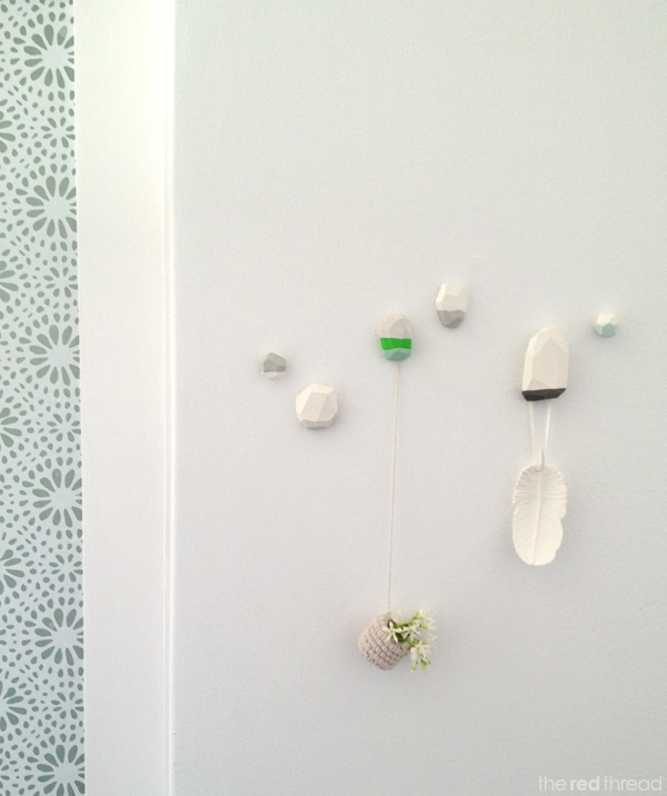 DIY faceted wall hooks painted in various colors
