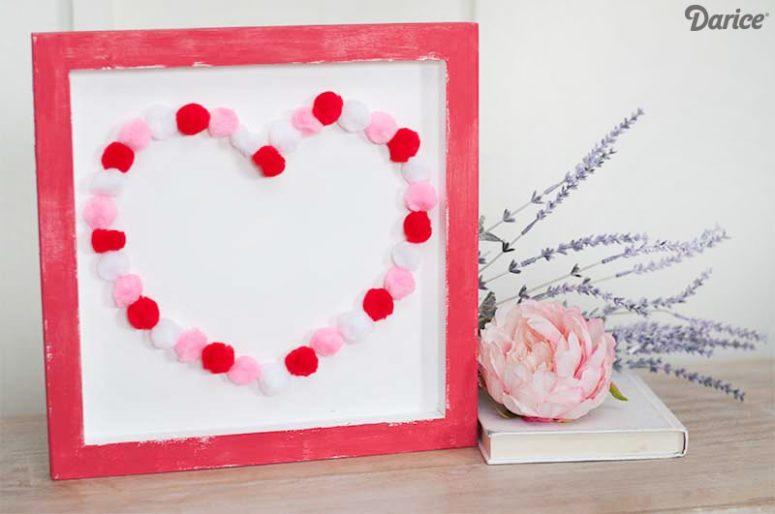 DIY colorful pompom heart sign for Valentine's Day (via www.craftsbycourtney.com)