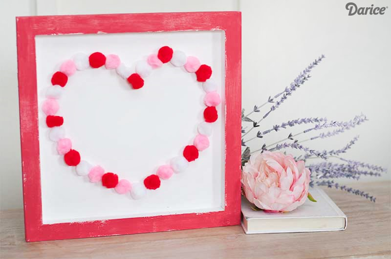 DIY colorful pompom heart sign for Valentine's Day