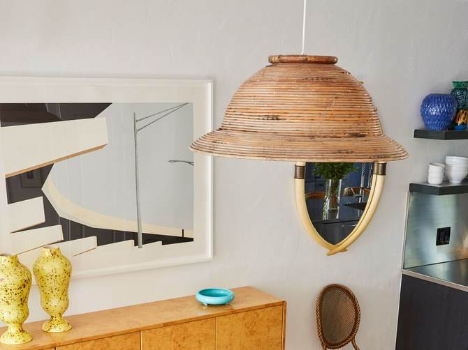 DIY wicker pendant lamp of a woven basket (via www.architecturaldigest.com)
