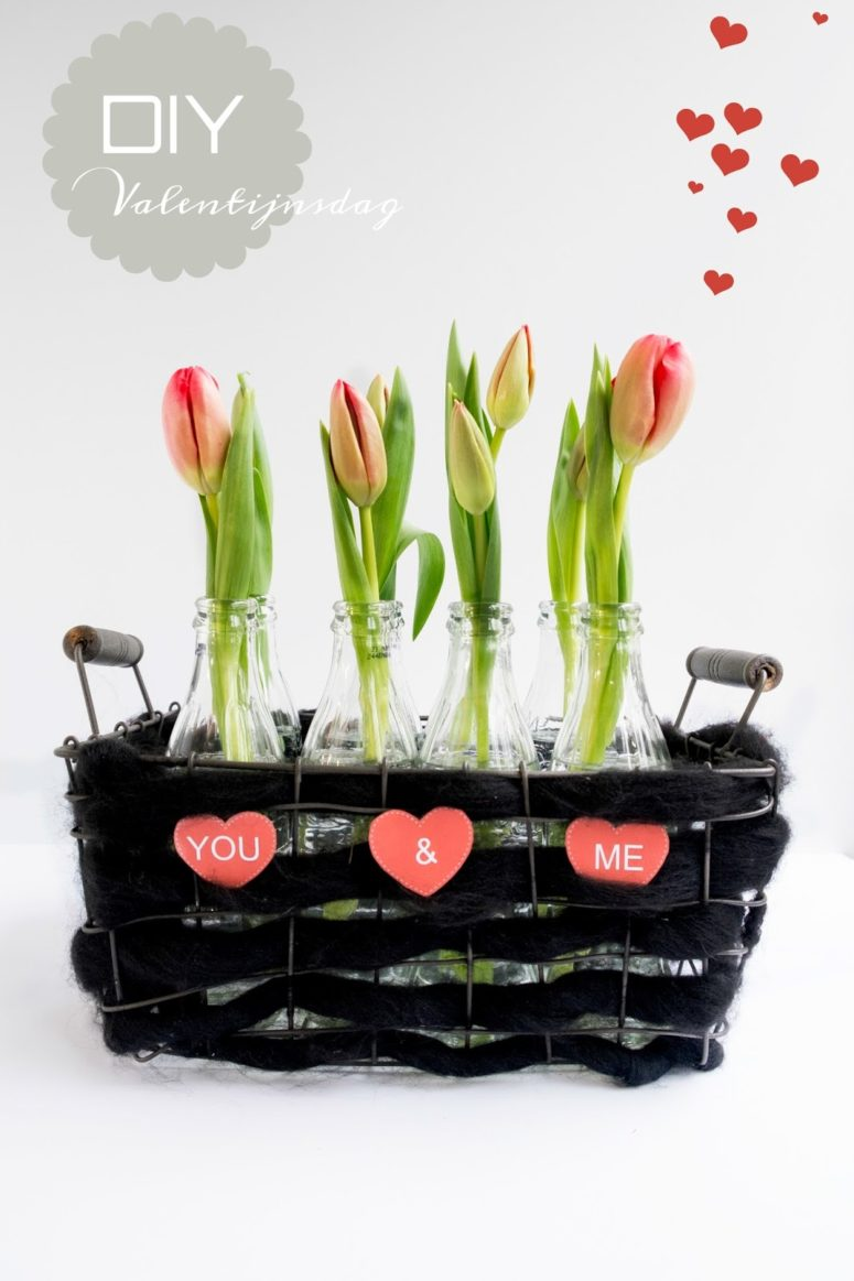 DIY woven basket with bottle vases and fresh blooms (via www.elsarblog.com)