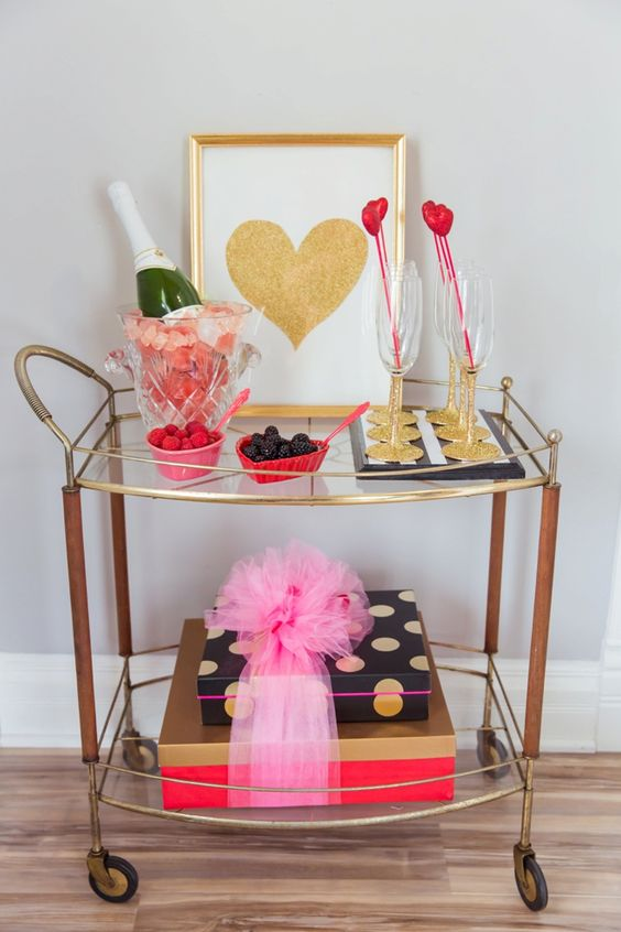 glitter touches, a glitter heart sign and some petals and hearts make this cart Valentine like