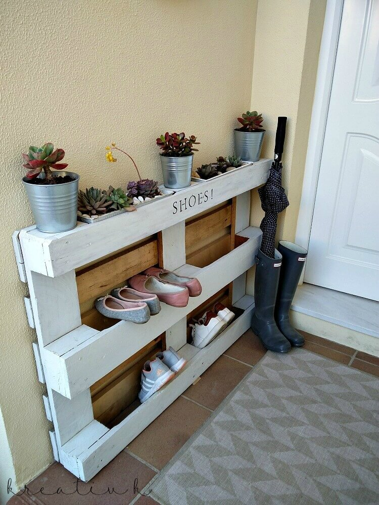 DIY pallet shoe rack with planters on top