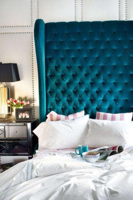 a bold turquoise tufted wingback headboard makes a statement in your bedroom with its look and color