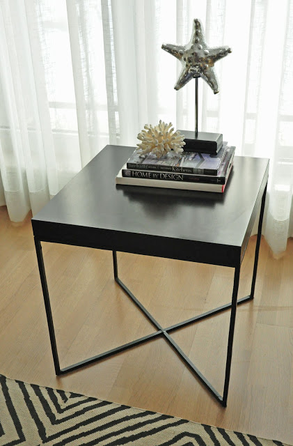 a chic Lack table hack in black with a new metal base will easily fit any modern or Scandinavian space