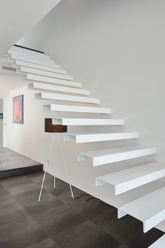 a white floating staircase of metal attached to the wall is a gorgeous modern idea