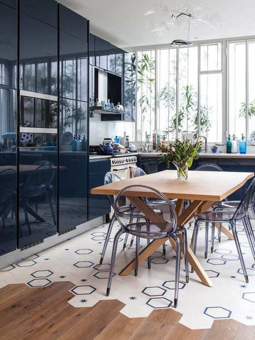 bright hex tiles in the kitchen and light-colored laminate in the rest of the space
