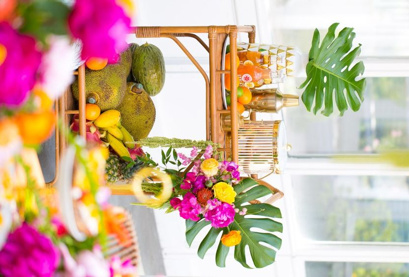 decorate your bar cart with storing all kinds of tropical fruit in the lower part of it