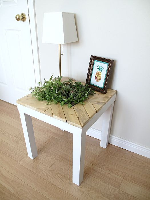 a chic farmhouse Lack table hack with light colored wood and a planter right in the center