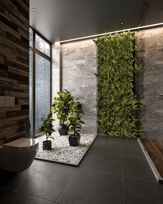a lush greenery wall and some potted plants are a cool idea for a contemporary and bold space