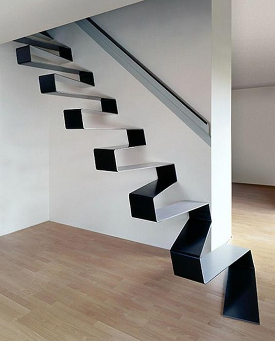 an edgy floating staircase of a single metal folded sheet is a unique idea to try