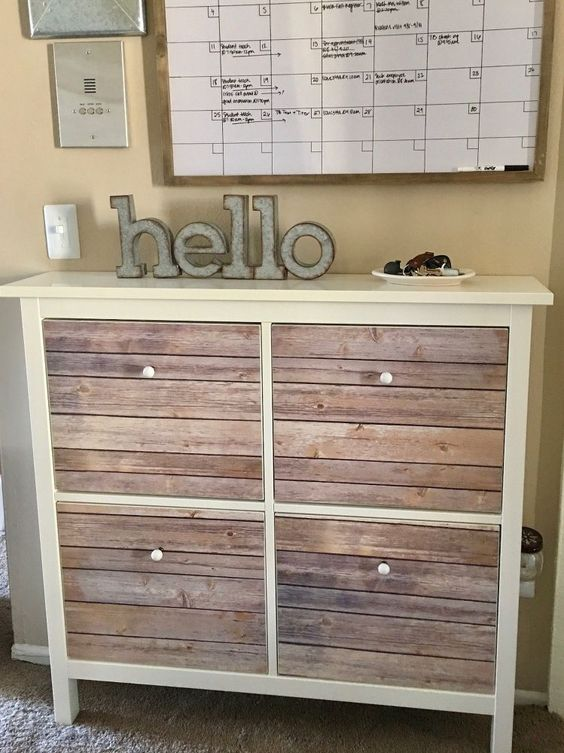 a cozy IKEA Hemnes shoe storage hack with aged wood pieces is a gorgeous rustic idea