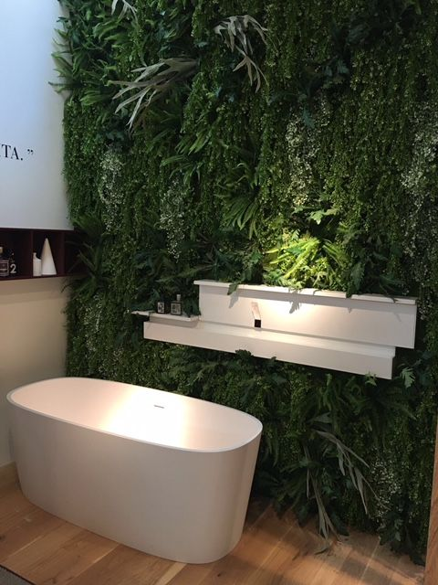 a lush greenery wall next to your bathtub is a gorgeous idea to bring a piece of nature inside