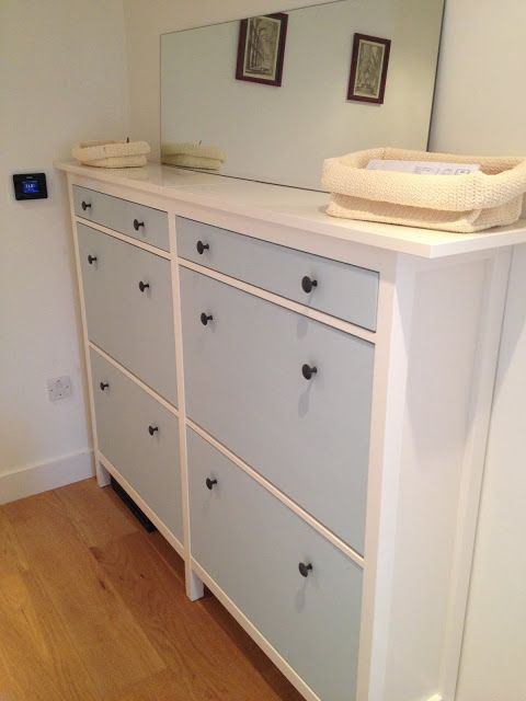 a cute IKEA Hemnes shoe storage in light blue with black knobs is ideal for a kids' space