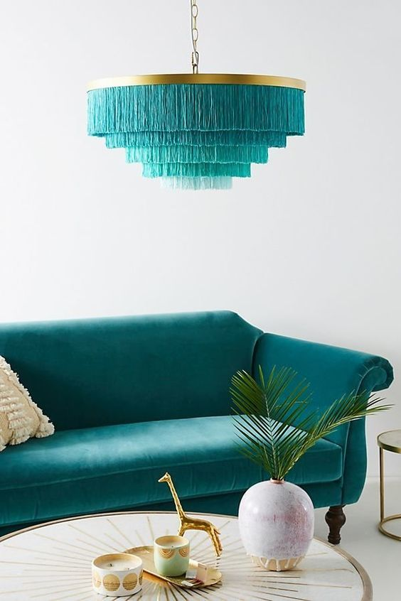 a flirty fringy lampshade in layers with a brass base is a bold statement