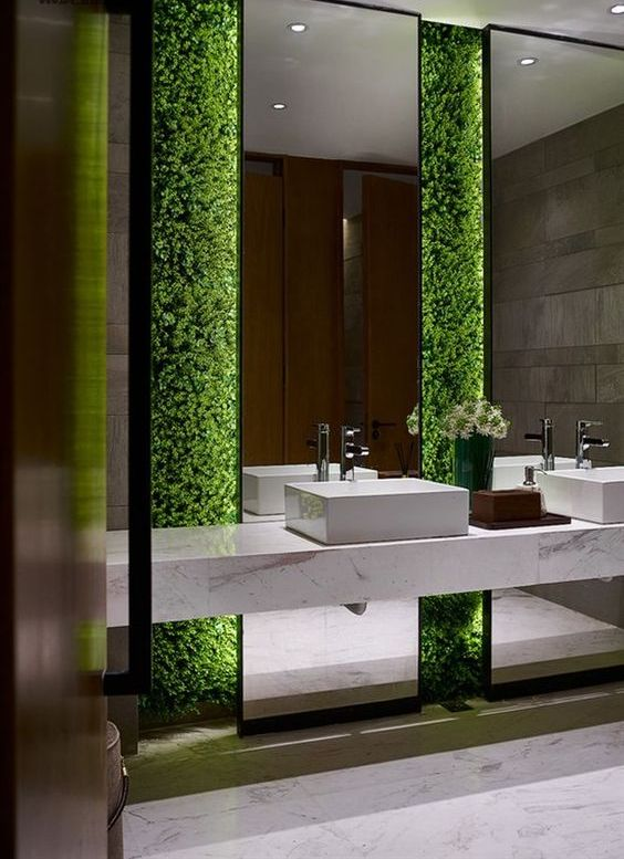 a living greenery wall in a bathroom is a chic idea for any style and decor, it's very refreshing