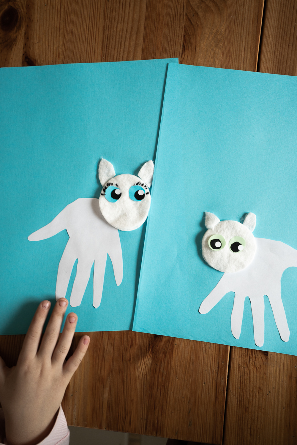 cute snow leopard handprint craft for kids