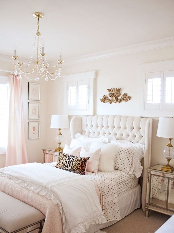 a chic creamy upholstered bed with a tufted wingback headboard is a welcoming and soothing piece