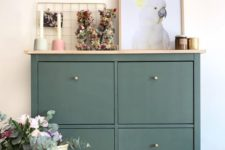 06 a dark green IKEA Hemnes shoe cabinet hack with a wooden countertop is a stylish idea for a modern home