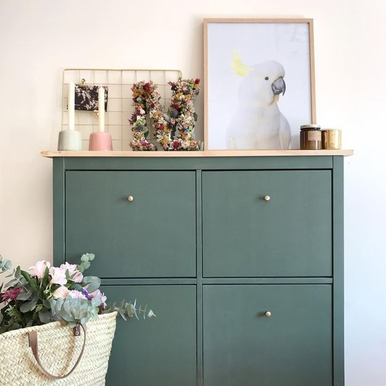 a dark green IKEA Hemnes shoe cabinet hack with a wooden countertop is a stylish idea for a modern home