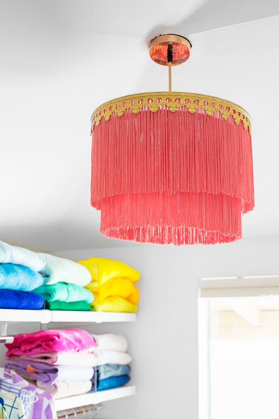 a hot pink long fringe layered lampshade is a bright and gypsy-inspired lampshade for any space