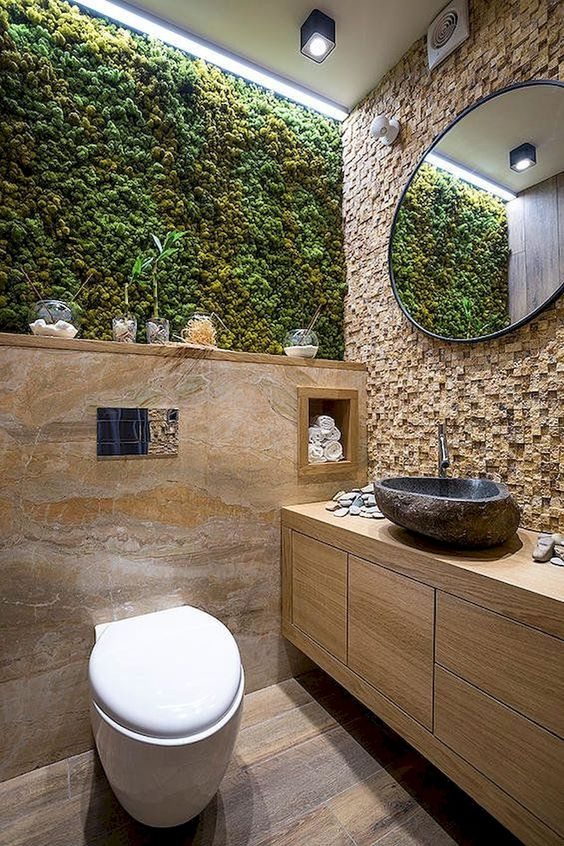 a moss wall in your bathroom is a chic and stylish idea for a modern bathroom, it's a low maintenance idea