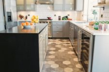 06 grey and white hex tiles in the cooking zone contrast the dark laminate