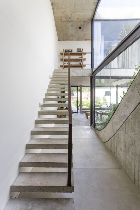 a minimalist staircase for an industrial home
