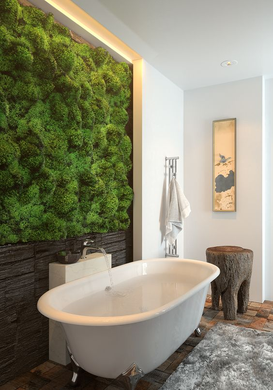a living moss wall with a wooden part is a cool idea for a strong natural feel in your bathroom
