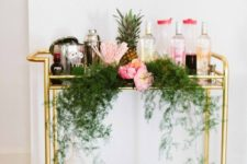 an awesome bar cart styled for a tropical-inspired party